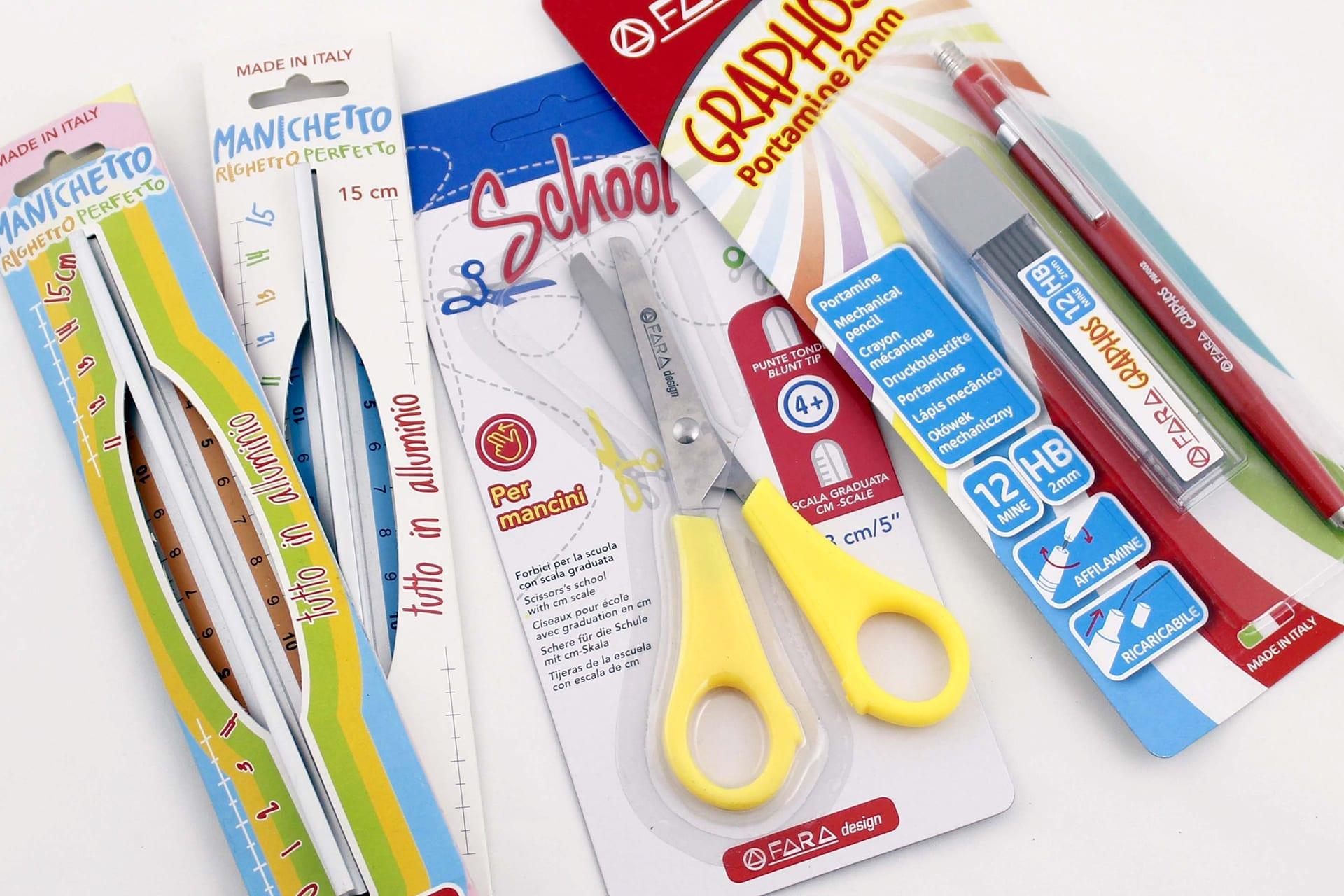 Oggetti vari per scuola: forbice, portamine e 2 righelli